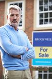 Mature Man Forced To Sell Home Through Financial Problems. Unhappy Mature Man Forced To Sell Home Through Financial Problems Stock Photos