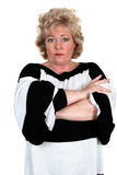 Unhappy mature woman. Woman with crossed arms and angry expression Stock Photography