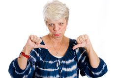 Unhappy Mature woman giving two thumbs down. Royalty Free Stock Image