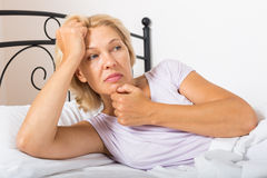 Unhappy mature woman Royalty Free Stock Photos