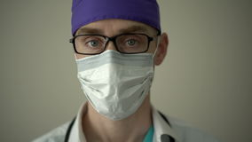 Unhappy medical professional looks into the camera stock video footage