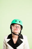 Funny woman wearing cycling helmet portrait pink background real Stock Images