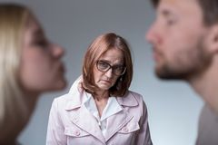 Unhappy mother-in-law. Image of unhappy mother-in-law and her amorous son Royalty Free Stock Image