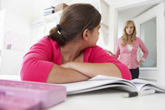 Unhappy Mother Telling Off Daughter For Not Doing Homework Royalty Free Stock Photo