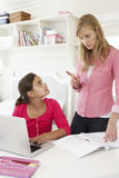 Unhappy Mother Telling Off Daughter For Not Doing Homework Stock Photos