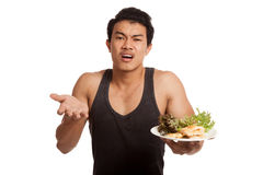 Unhappy muscular Asian man with clean food Stock Photography