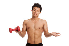 Unhappy muscular Asian man with dumbbell Stock Photography