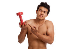 Unhappy muscular Asian man with dumbbell Stock Photo