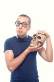 Unhappy nerd and skull Stock Image