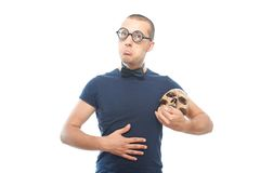 Unhappy nerd and skull Royalty Free Stock Photography