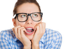Unhappy nerdy woman craving for something biting her nails Royalty Free Stock Photo