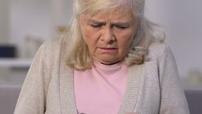 Unhappy old woman counting euro banknotes, small pension, lack of money, poverty. Stock footage stock video footage