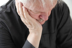 Unhappy older man. Older man slumped in depression or grief Royalty Free Stock Photography