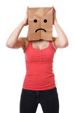 Unhappy paper bag girl Stock Images