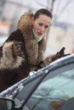 Unhappy pedestrian. Unhappy female pedestrian argues with a car driver on the street stock photos