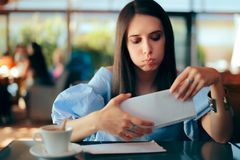 Worried Woman Receiving Documents in an Envelope royalty free stock images