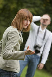 Unhappy photographer and female model Stock Photography