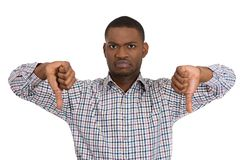 Unhappy pissed off man giving two thumbs down gesture Stock Photo