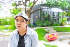 Unhappy portrait cute young innocent fat teen. Unhappy portrait cute young innocent asian teen expression boring Royalty Free Stock Photography
