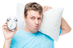 Unhappy portrait of a man sleepy with an alarm clock Stock Images