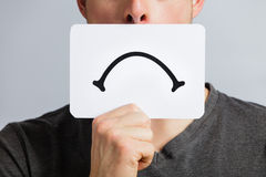 Unhappy Portrait of someone Holding a Sad Mood Board Royalty Free Stock Image