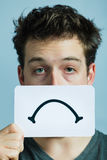 Unhappy Portrait of someone Holding a Sad Mood Board Royalty Free Stock Photo