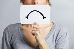 Unhappy Portrait of someone Holding a Sad Mood Board Stock Image
