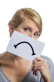 Unhappy Portrait of someone Holding a Sad Mood Board Stock Photo