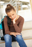Unhappy Pre teen girl in school stock image