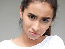 Unhappy Pretty Teenager. A young female hispanic teen Royalty Free Stock Images