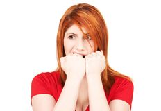 Unhappy redhead woman. Picture of unhappy redhead woman over white stock photo