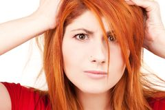 Unhappy redhead woman Royalty Free Stock Image