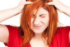 Unhappy redhead woman. Picture of unhappy redhead woman over white royalty free stock images
