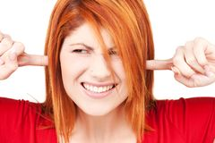 Unhappy redhead woman Stock Image