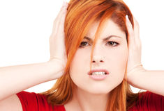 Unhappy redhead woman Royalty Free Stock Images
