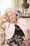Unhappy Retired Senior Woman Sitting On Sofa At Home Royalty Free Stock Photography