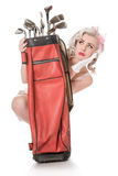 Unhappy retro girl peeking out from behind red golf bag, isolate Royalty Free Stock Photos