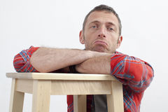 Unhappy 40s man with casual body language expressing frustration Royalty Free Stock Photo