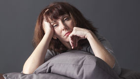 Unhappy 50's woman thinking about aging issues Royalty Free Stock Image