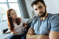Unhappy sad couple having a conversation. Unpleasant discussion. Unhappy sad depressed couple looking at each other and having an unpleasant conversation while stock photography