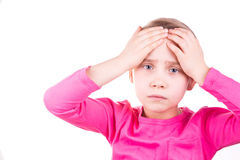 Unhappy sad little girl with headache. Isolated over white background Royalty Free Stock Image