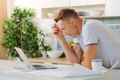 Unhappy sad man working at home Stock Image