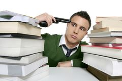 Unhappy sad student suicide gun metaphor Stock Images