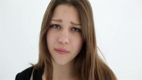 Unhappy sad teenage girl isolated at white background.  stock video footage