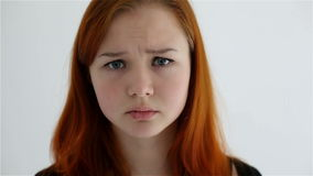Unhappy sad teenage girl isolated at white background stock video footage