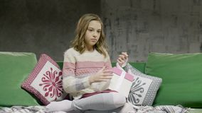 Unhappy Sad Teenage Girl Sitting Open Gift Box. One beauty offended lady sit on sofa close up and discover present from parents. Concept of family love and care stock video footage