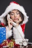 Unhappy Santa girl on the phone stock photos