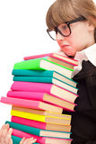 Unhappy school girl with stack color books Royalty Free Stock Photography