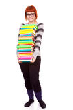 Unhappy school girl with stack color books Stock Photos