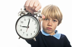 Unhappy schoolboy with clock Stock Images